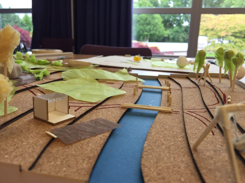 Model of a garden with a river